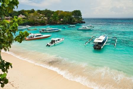 Mooring of boats in a bay of tropical island Lembongan