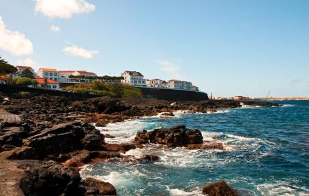 clinker tile: Town San Rock on an ocean coast, island Piko