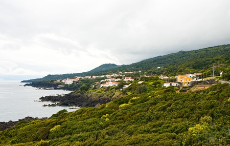 The island Pico, a village on the shore of the ocean photo