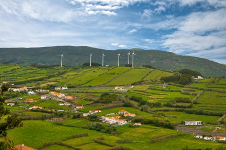 Rural landscape with wind generators on a hill photo