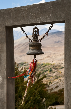 The bell at the entrance to the monastery Muktinath Stock Photo - 15899976