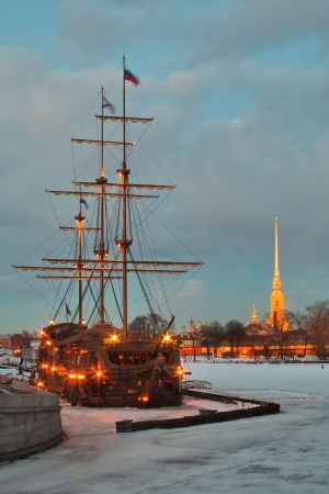 Winter landscape with a sailing ship against the Peter and Paul fortress, Saint-Petersburg Stock Photo - 17192618