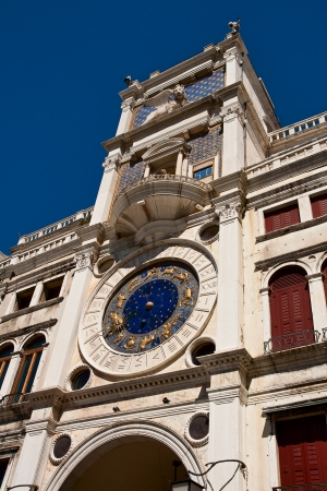 The clock tower on the square San Marco in Venice photo