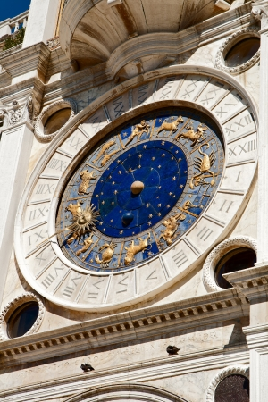 The clock tower on the Piazza San Marco in Venice photo