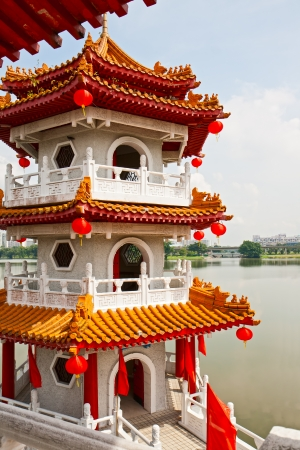 Pagoda on lake in the Chinese garden, Singapore photo