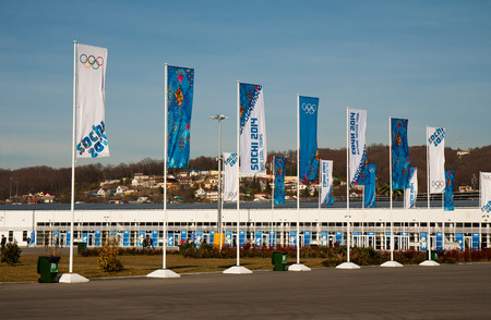 SOCHI, RUSSIA.  FEBRUARY 07, 2014 - Olympic flags in front of the entrance in the Sochi Olympic Park