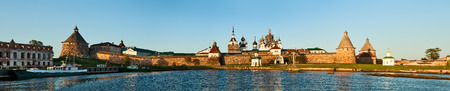 Panoramic view on Solovetsky Monastery from the Bay of well-being at sunset, Russia. photo