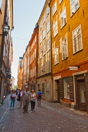 STOCKHOLM - AUGUST 18, 2011 - Tourists walk along the narrow streets of Stockholm.