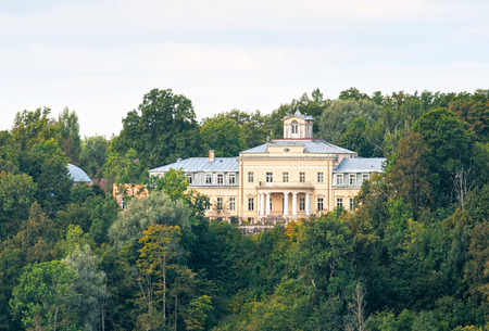 gauja: Krimulda Palace on the hill in the dense forest Editorial