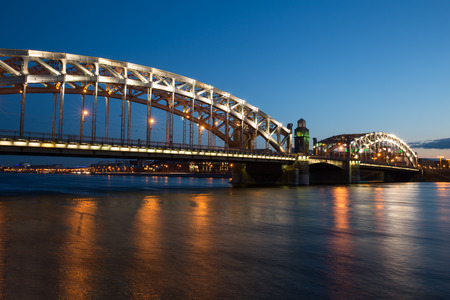 peter the great: Peter the Great Bridge in Saint-Petersburg with lights in the summer night Stock Photo