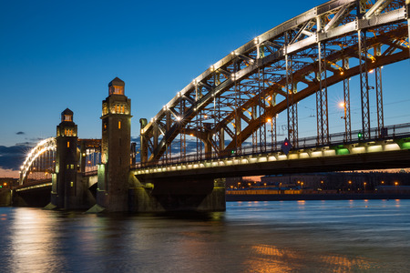 Peter the Great Bridge in Saint-Petersburg with lights in the summer night 免版税图像