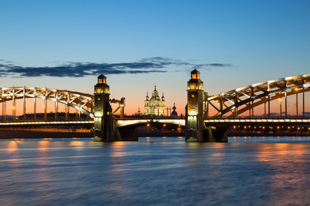 peter the great: Peter the Great Bridge and Smolny Cathedral in Saint-Petersburg with lights in the summer night