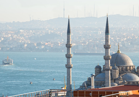 cami: Istanbul, view of the New mosque (Yeni Cami), Bosphorus and Asian shore in the air haze. Turkey