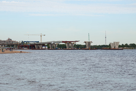 poling: ST. PETERSBURG, RUSSIA - JUNE 06, 2015: Construction western high speed diameter. Central Section, Bridge over the river Big Nevka