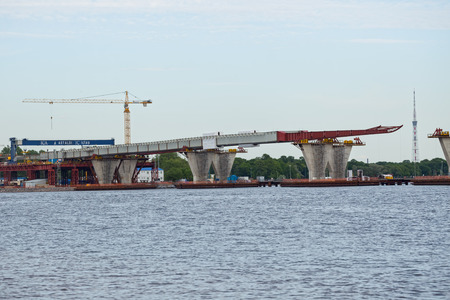 poling: ST. PETERSBURG, RUSSIA - JUNE 06, 2015: Construction western high speed diameter. Central Section, Bridge over the river