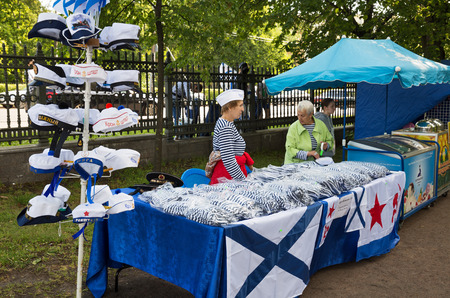 saleswomen: ST. PETERSBURG, RUSSIA - JULY 26, 2015: Day of the Navy in Kronstadt. Two saleswomen sell Souvenirs with marine symbols Editorial