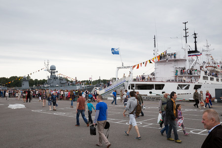 sightseers: ST. PETERSBURG, RUSSIA - JULY 26, 2015: Day of the Navy in Kronstadt. People stand in line to visit the ship