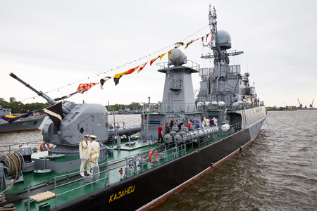 sightseers: ST. PETERSBURG, RUSSIA - JULY 26, 2015: Small anti-submarine ship Kazanets takes visitors on board on the day Navy Editorial