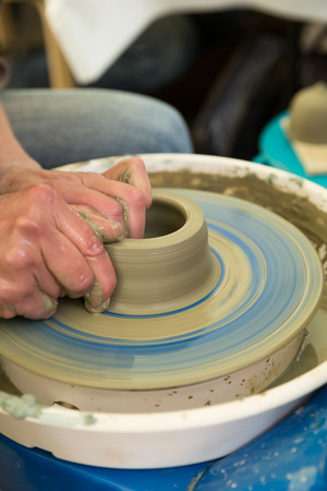 potters wheel: Hands making pottery on potters wheel, close up