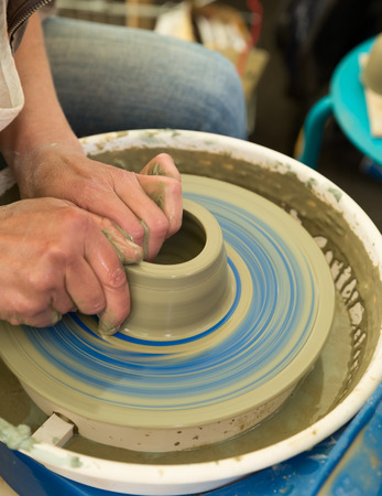 potters wheel: Hands making pottery on potters wheel Stock Photo