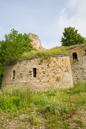 loopholes: Ivangorod Fortress Ruins. The round corner tower with loopholes.