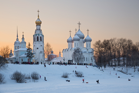 sledging people: VOLOGDA, RUSSIA - JANUARY 07, 2016: During the holidays, adults and children tobogganing in the city center, near the Kremlin