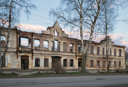 demolished house: The ruins of the burned house with the collapsed roof and ceiling Stock Photo