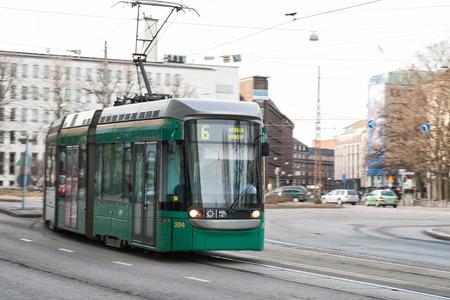 mart: HELSINKI, FINLAND - MART 31, 2012: Modern tram on the streets of Helsinki. Editorial