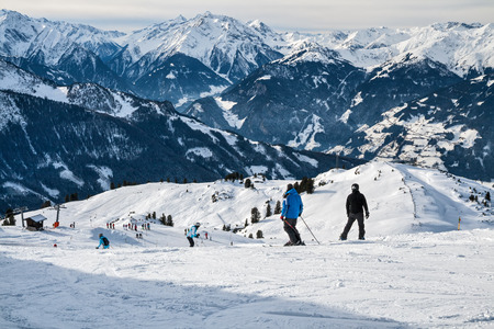 skiers: ZILLERTAL ARENA, AUSTRIA - JANUARY 04, 2011 - Skiers and snowboarders move out down the mountain ski slope in Alps