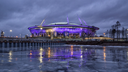SAINT PETERSBURG, RUSSIA - DECEMBER 25, 2016: New stadium football club Zenit Saint Petersburg on Krestovsky island at night with colored lights