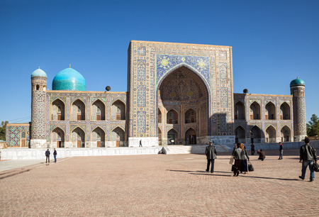 registan: SAMARKAND, UZBEKISTAN - OCTOBER 15, 2016:  People on the Registan Square near Tilya Kori Madrasah