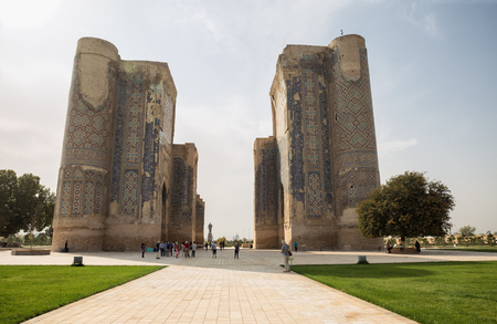SHAKHRISABZ, UZBEKISTAN - OCTOBER 23, 2016: The tour group near the ruins of AK-Saray Palace of Timur in Shahrisabz.