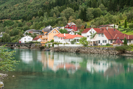 Small Norwegian town Stryn on river bank