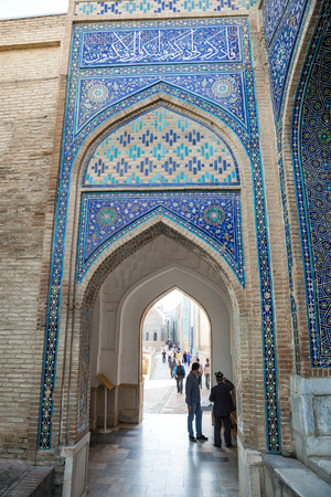 SAMARKAND, UZBEKISTAN - OCTOBER 15, 2016:  People visit the mausoleum complex Shah-I-Zinda