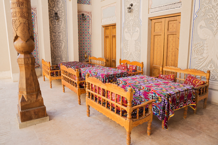 BUKHARA, UZBEKISTAN - OCTOBER 19, 2016: Hotel interior in Bukhara. Inner courtyard decorated in national style