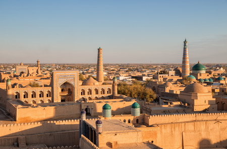 View of the ancient fortress Ichan Kala from the observation deck at sunset. Khiva, Uzbekistan