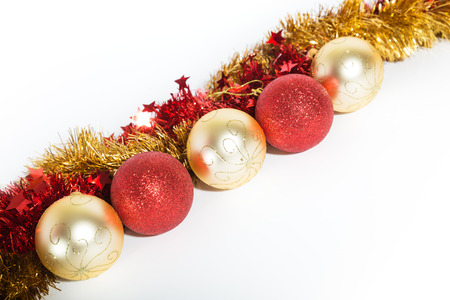 Christmas decorations red and golden color on a white background - balls and tinsel
