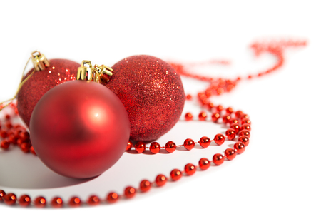 Christmas decorations of red color on a white background - balls and beads Stock Photo