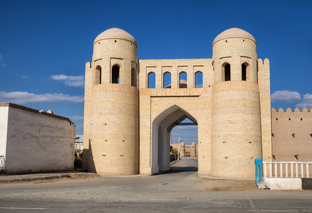 The restored southern gate Angaryk of the outer fortress Dishan kala and behind them the gate Tash-Darvaza of the inner fortress Ichan-Kala. Khiva, Uzbekistan