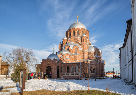 SVIYAZHSK, RUSSIA - JANUARY 05, 2018: People go to temple on Christmas eve. Saint John the Baptist Monastery in Sviyazhsk