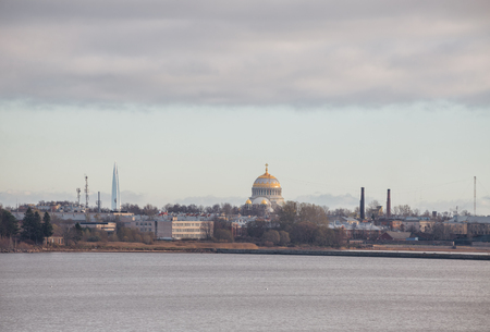 View of Kronstadt from the Gulf of Finland. Naval Cathedral and Lakhta Center skyscraper