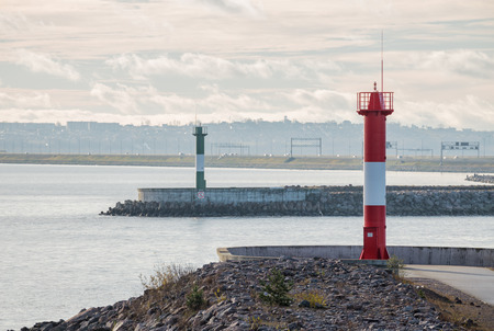 Two lighthouses at exit from Neva Bay against background of St. Petersburg dam. Kronstadt, Russia