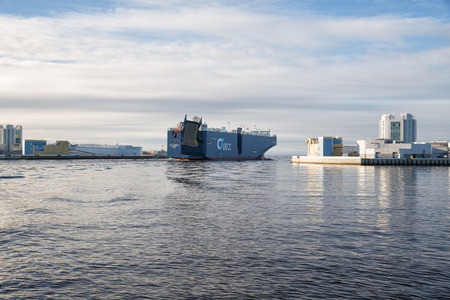 ST. PETERSBURG, RUSSIA - NOVEMBER 04, 2018: largest vehicles carrier AUTO ENERGY leaves the port of St. Petersburg and passes through  S-1 navigation pass of Saint Petersburg Dam Editorial