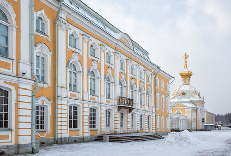 SAINT PETERSBURG, RUSSIA - JANUARY 22, 2018: Peterhof in winter. Grand Palace and outbuilding under the coat of arms from the Lower Park