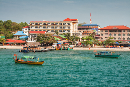 Sihanoukville, Cambodia. View from the sea to the city beach and boat pier Stock Photo