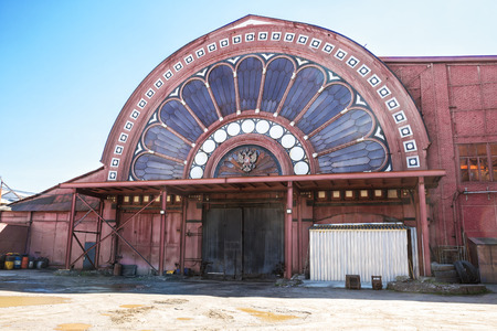 Industrial architecture. Stained-glass window on the end wall of the iron-rolling plant, one of the old shops of Izhora plants, Kolpino, St. Petersburg, Russia