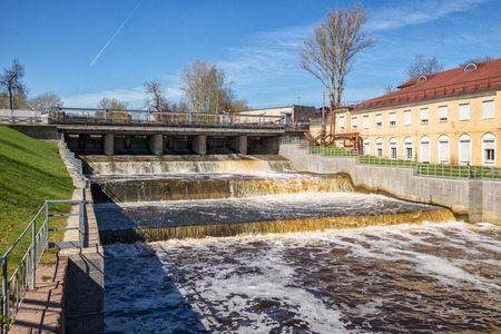 Overflow dam on the Izhora River, view from the territory of the Izhora Plants, Kolpino, St. Petersburg, Russia