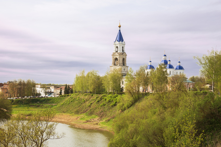 Scenic cityscape Kashin town in spring, Resurrection Cathedral on bank of the Kashinka River, Tver region, Russia Фото со стока