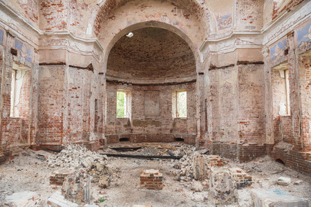 Ruins of old abandoned church. The premises of the church covered with broken bricks and debris.. Church of the Nativity of Christ in village Rozhdestvo, Tver region, Russia Banco de Imagens