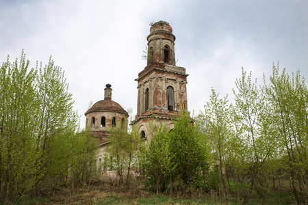 Ruins of an old abandoned russian church with bell tower. The Church of the Nativity of Christ in Rozhdestvo village in Tver region, Russia